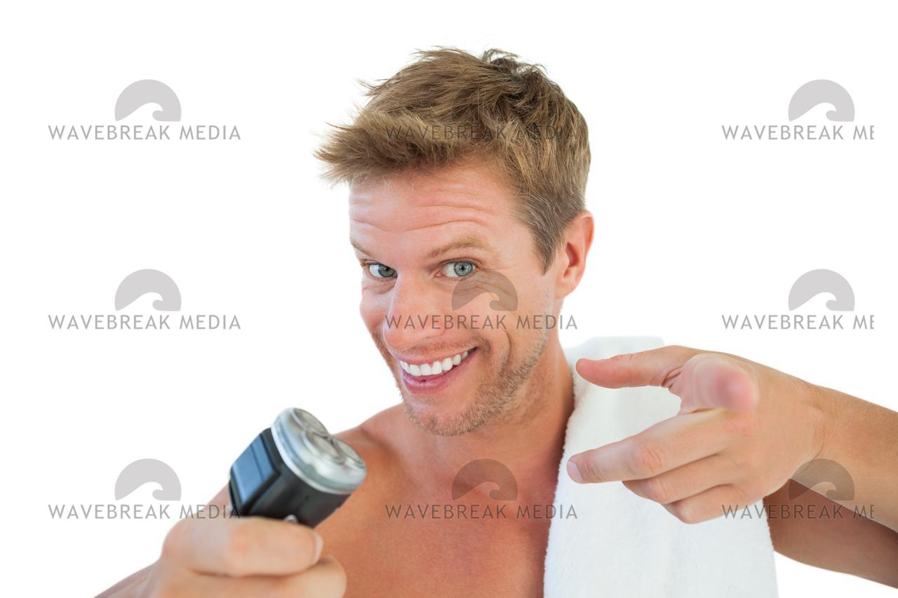 """Cheerful man about to shave his stubble"" stock image"