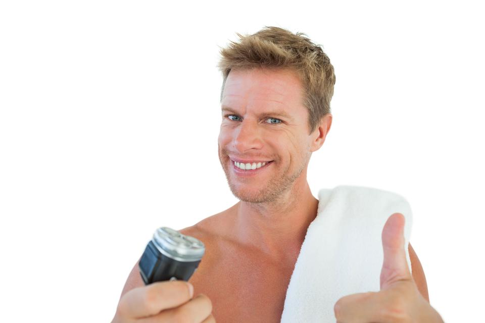 """""""Cheerful man giving thumbs up while holding a razor"""" stock image"""