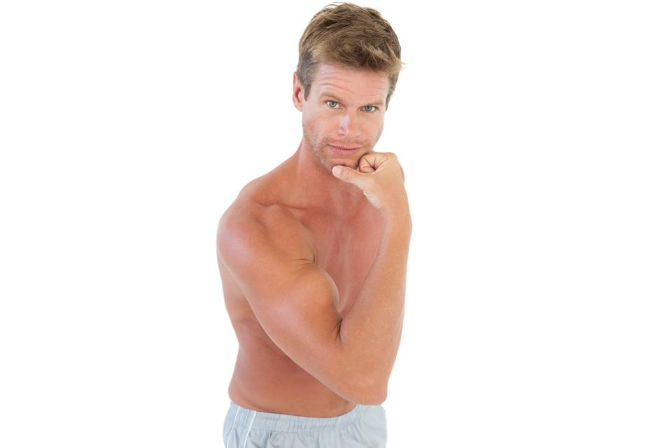 """""""Shirtless attractive man flexing muscles"""" stock image"""