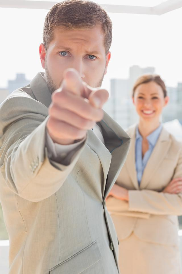 """""""Annoyed businessman pointing at camera"""" stock image"""