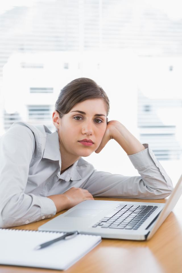 """""""Fed up businesswoman looking at camera"""" stock image"""