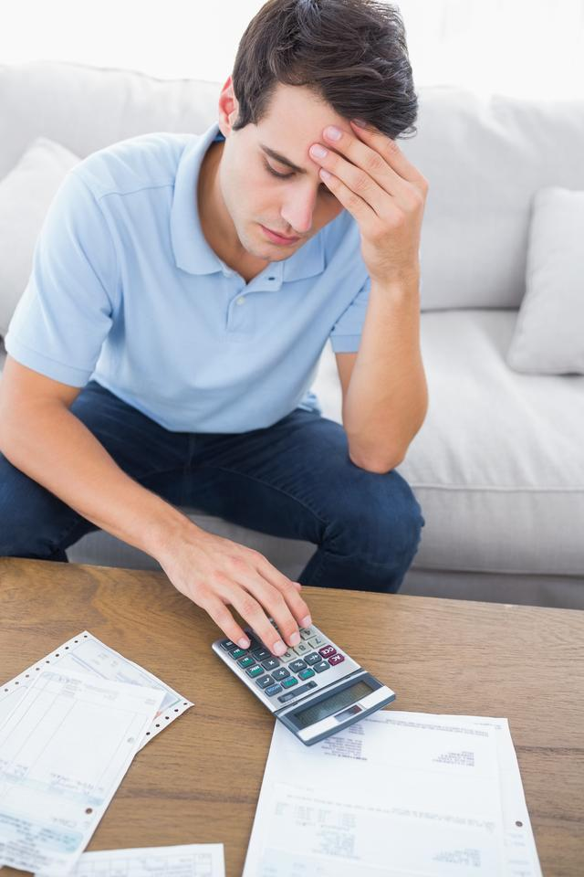 """Fearful man doing his accounts"" stock image"