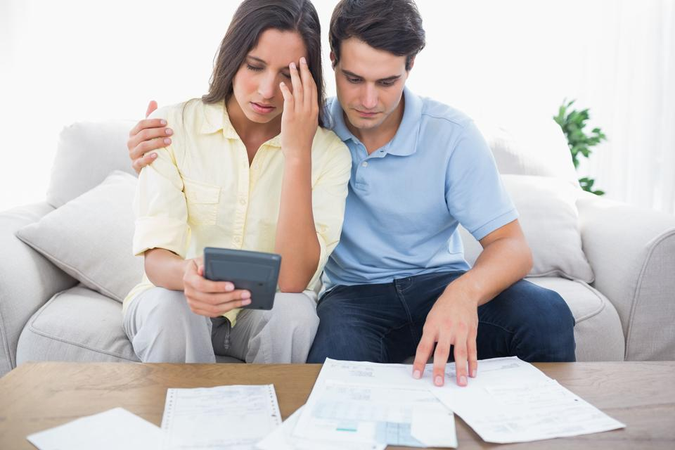 """Fearful couple doing their accounts"" stock image"