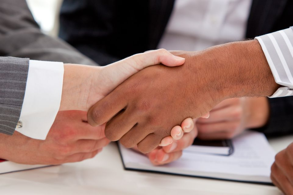 """""""Close up of businesspeople closing a deal"""" stock image"""