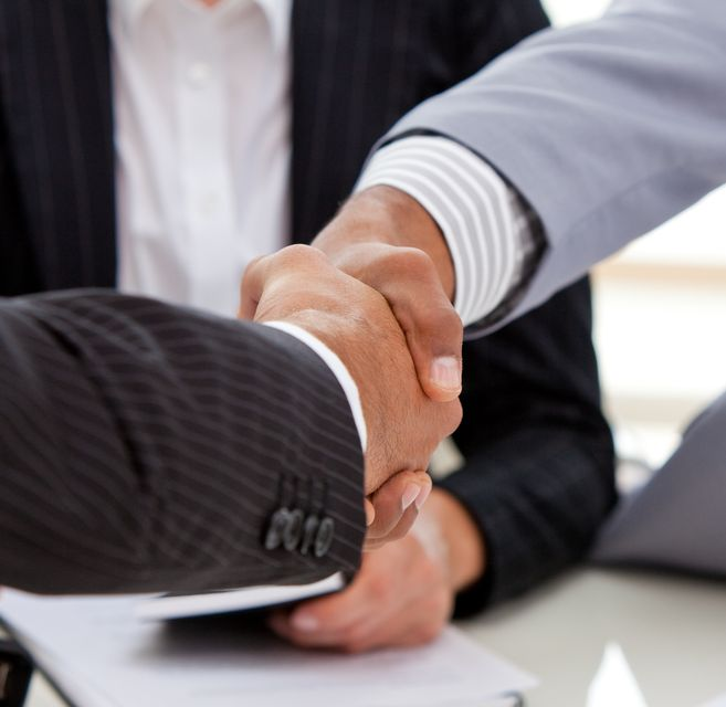 """""""Close up of businessmen closing a deal"""" stock image"""