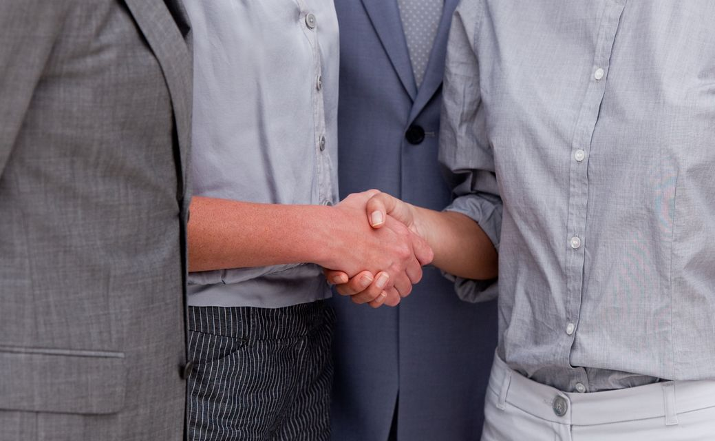 """""""Close up of a fortunate Business team closing a deal"""" stock image"""
