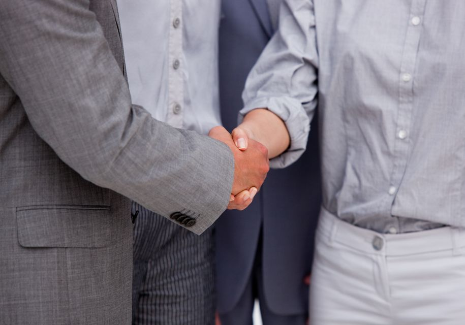 """""""Close up of a victorious Business team closing a deal"""" stock image"""