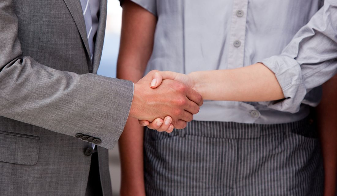 """""""Close up of a lucky Business team closing a deal"""" stock image"""
