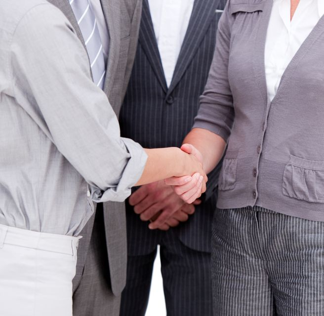 """""""Close up of a positive Business team closing a deal"""" stock image"""