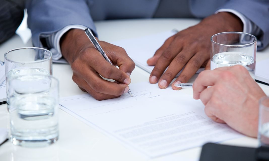"""""""Close up of ambitious business people closing a deal"""" stock image"""