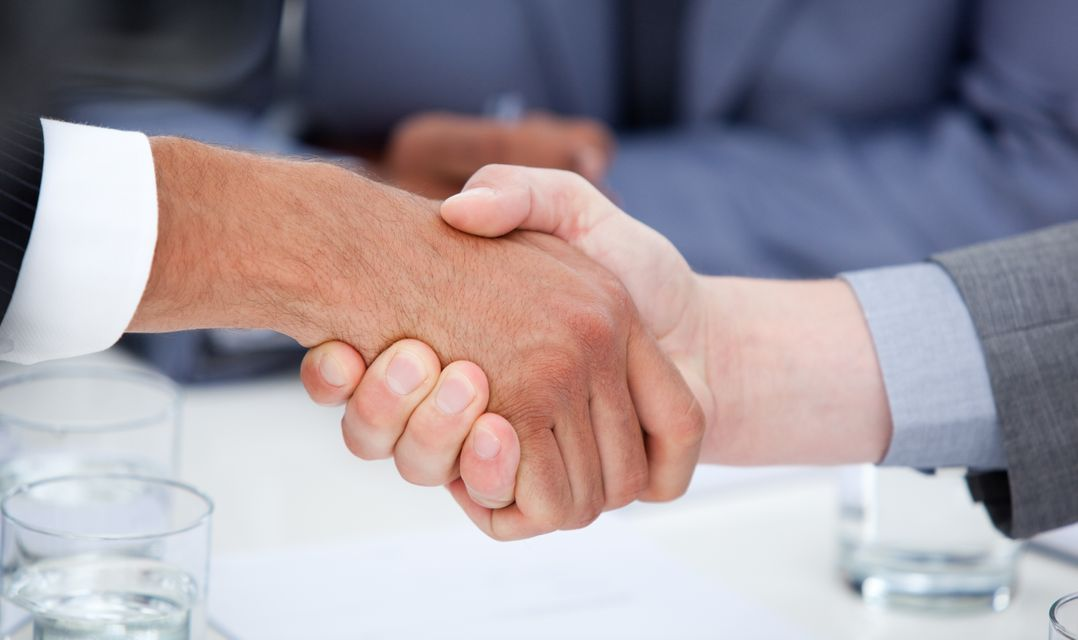 """""""Close up of confident business people closing a deal"""" stock image"""