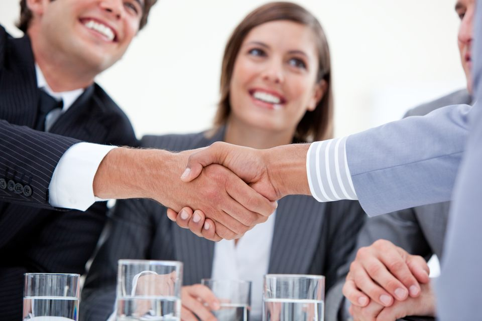 """""""Smiling business people closing a deal"""" stock image"""