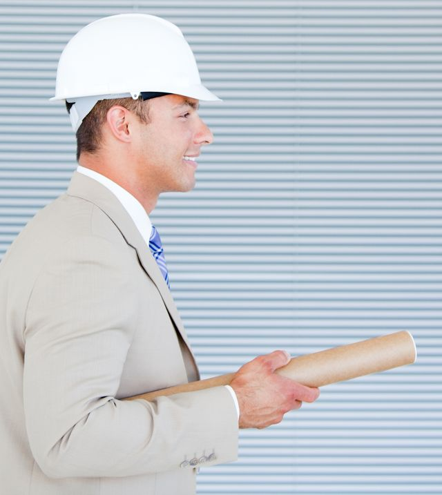 """Portrait of a confident architect wearing a hardhat"" stock image"
