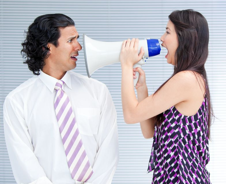 """""""Furious businesswoman yelling through a megaphone"""" stock image"""