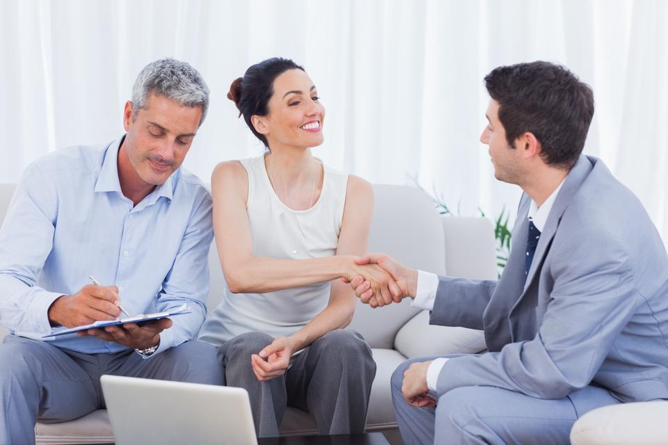 """""""Salesman closing a deal withcouple"""" stock image"""