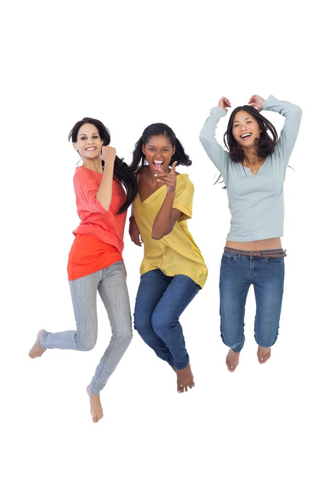 """""""Diverse young women jumping and looking at camera"""" stock image"""