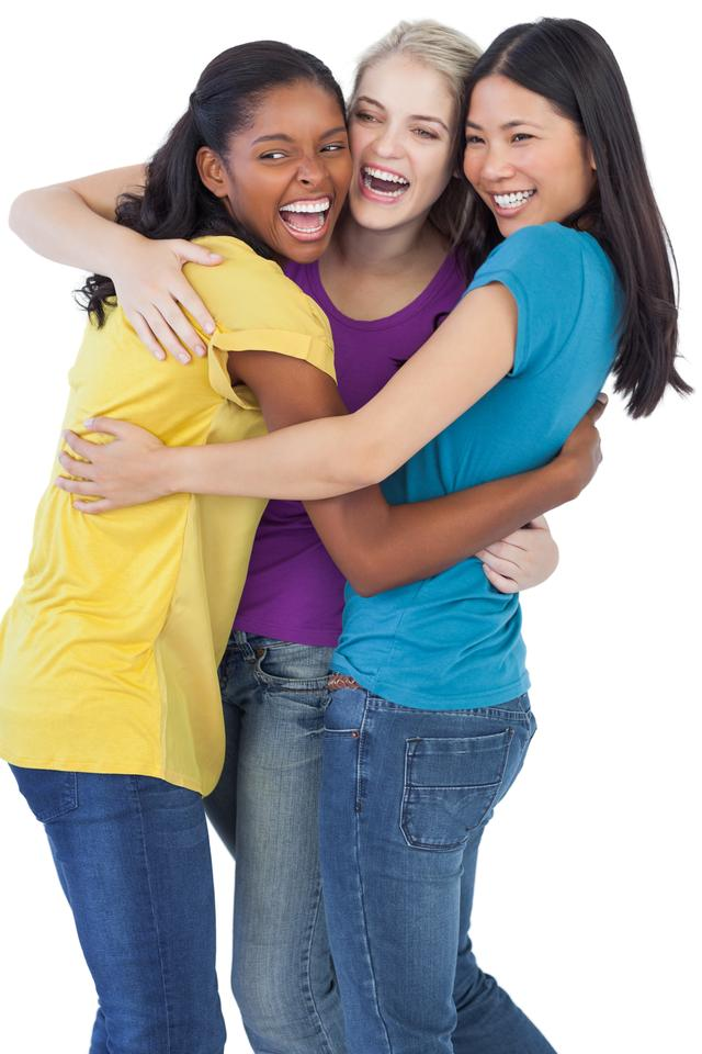 """""""Diverse laughing women embracing each other"""" stock image"""