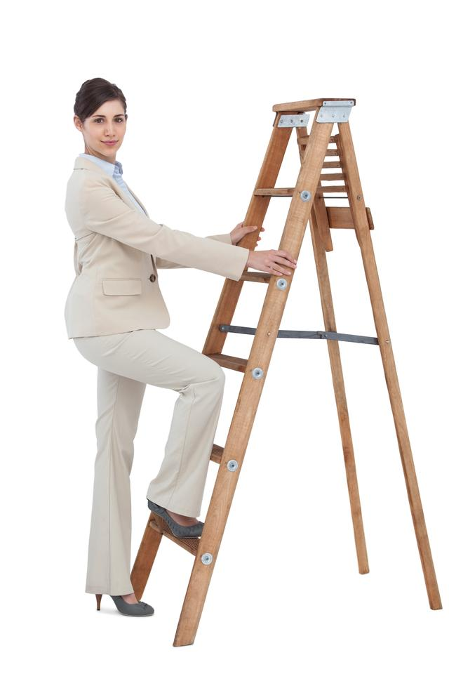 """Businesswoman climbing career ladder"" stock image"