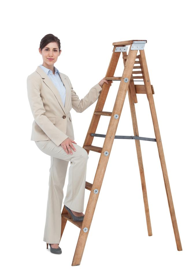 """Businesswoman climbing the career ladder"" stock image"