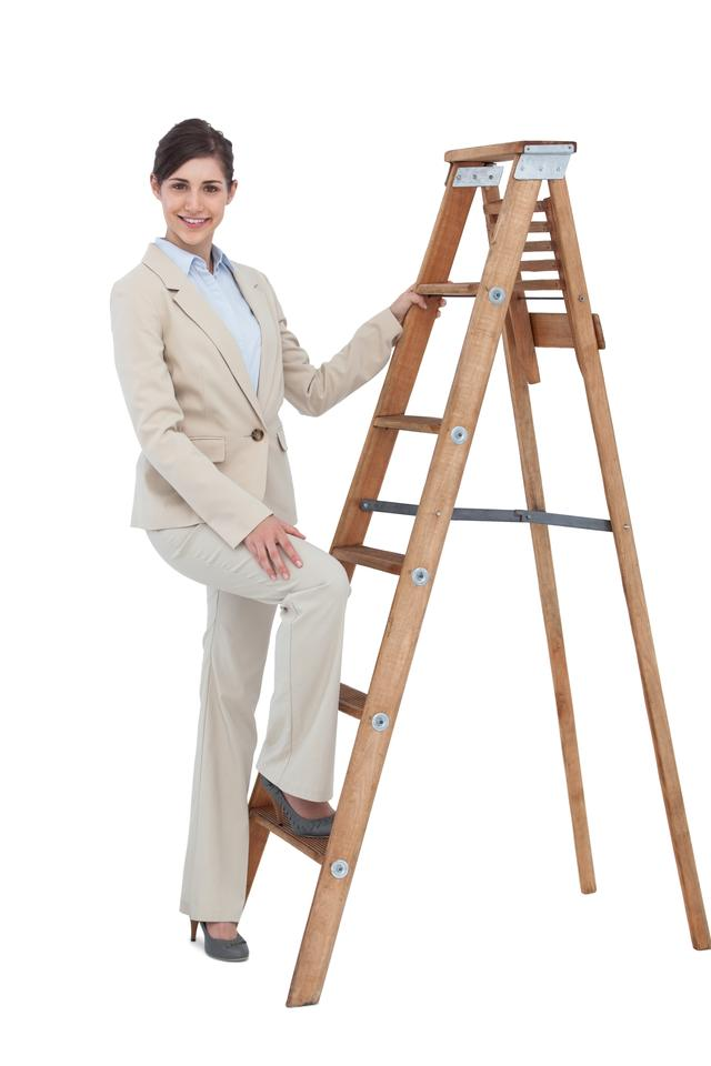 """Happy businesswoman climbing the career ladder"" stock image"