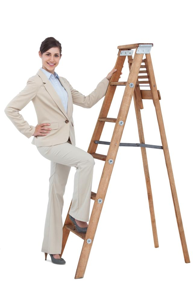 """Cheerful businesswoman climbing the career ladder"" stock image"