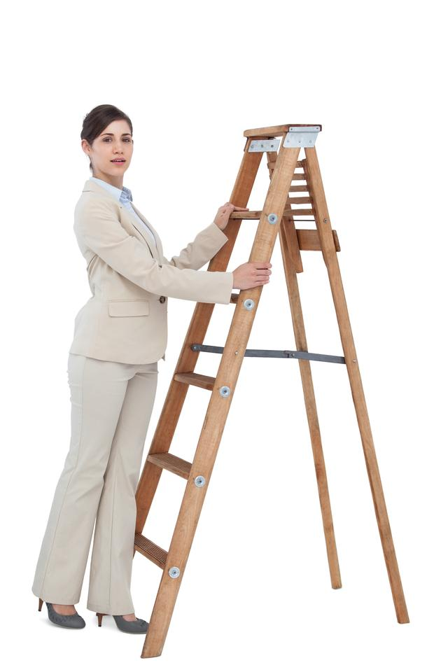 """Businesswoman at the bottom of the career ladder"" stock image"