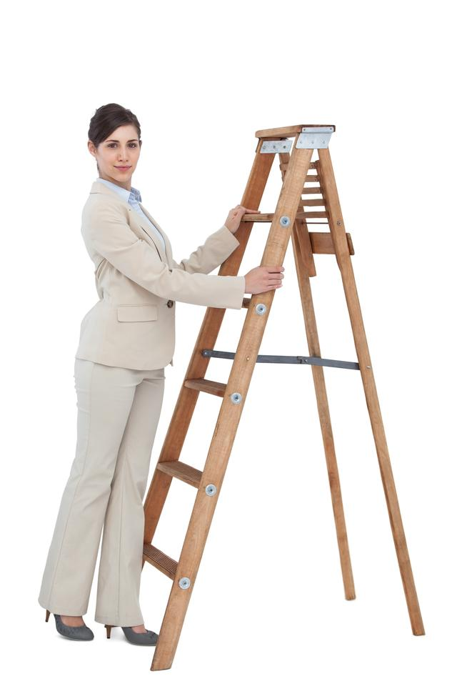 """Young businesswoman at the bottom of the career ladder"" stock image"