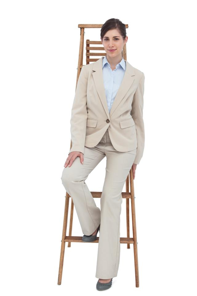 """Young businesswoman sitting on career ladder"" stock image"