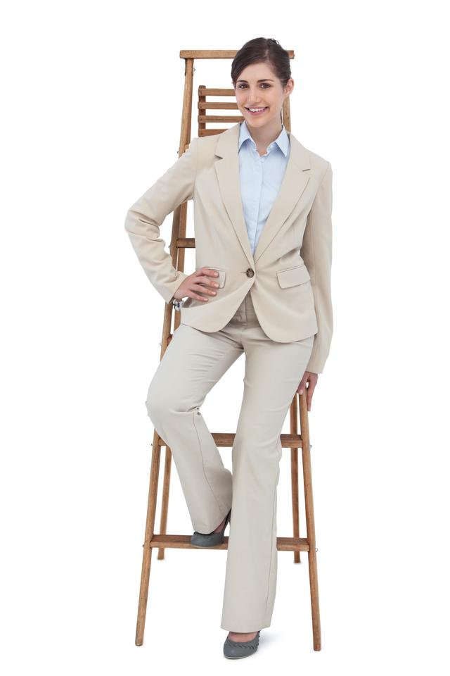 """Smiling businesswoman sitting on career ladder"" stock image"