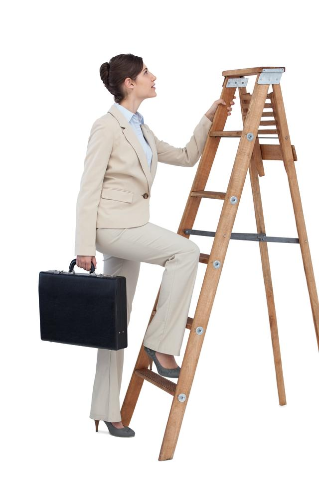 """Businesswoman climbing career ladder with briefcase"" stock image"
