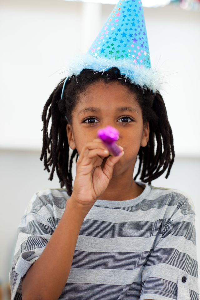 """""""Portrait of a little boy at a birthday party"""" stock image"""