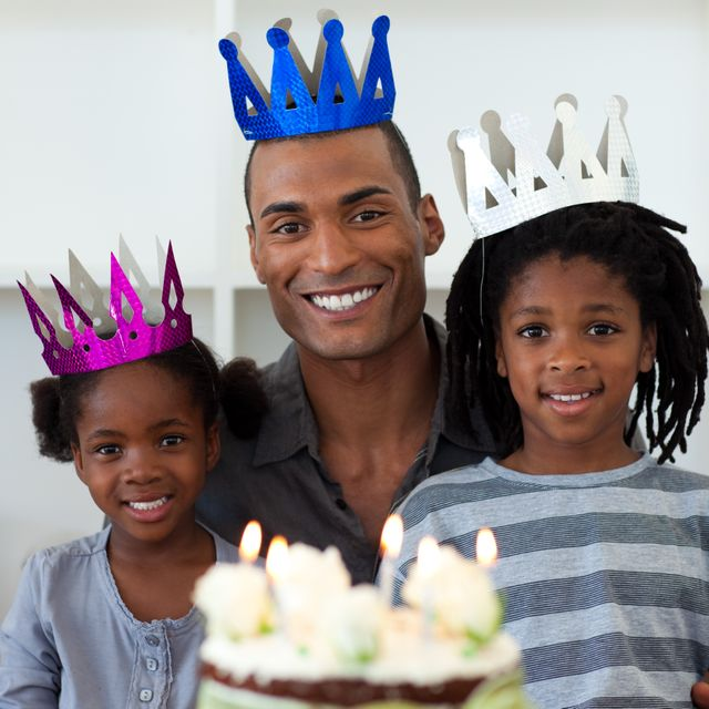 """""""Smiling father with his children celebrating a birthday"""" stock image"""