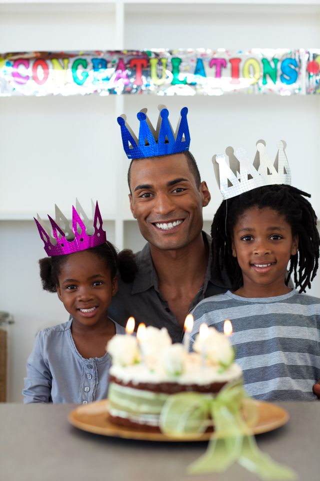 """""""Joyful father with his children celebrating a birthday"""" stock image"""