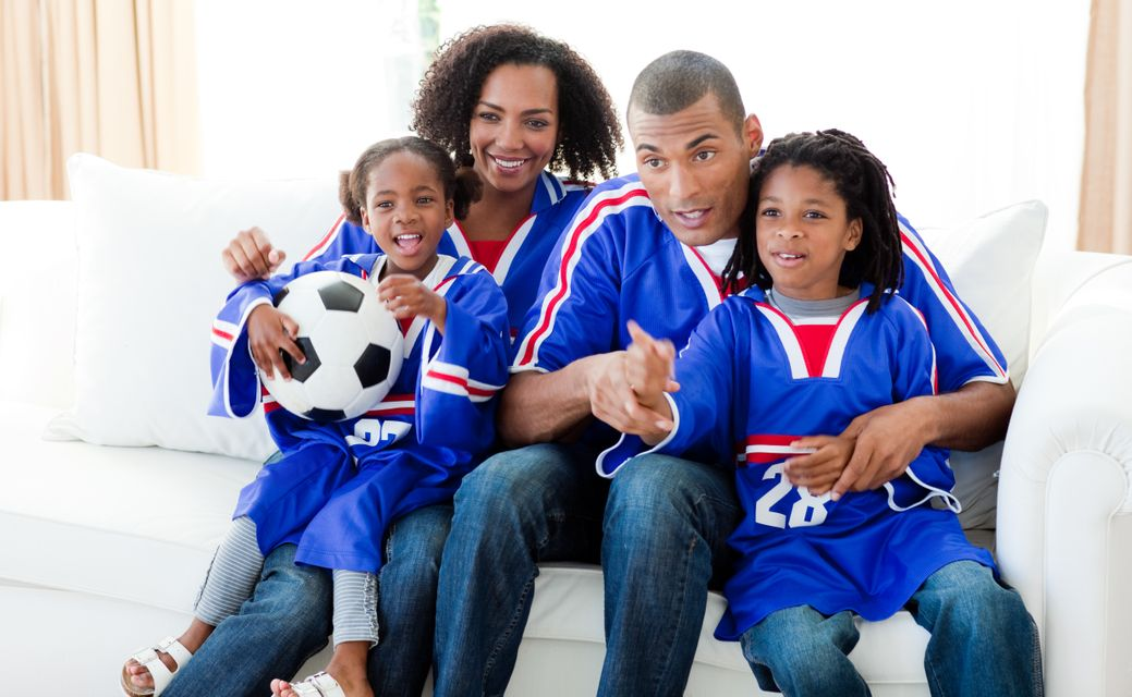 """""""Family watching a football match at home"""" stock image"""