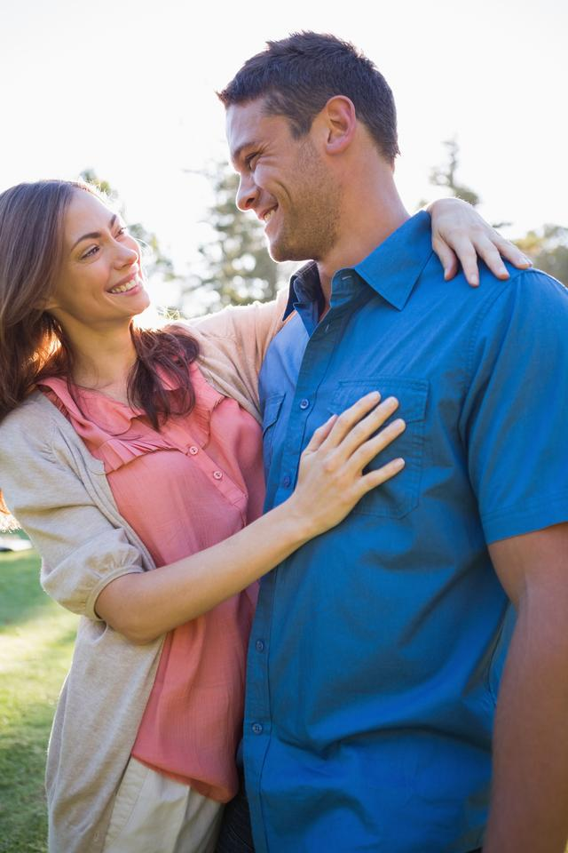 """""""Smiling couple looking at each other in eyes"""" stock image"""