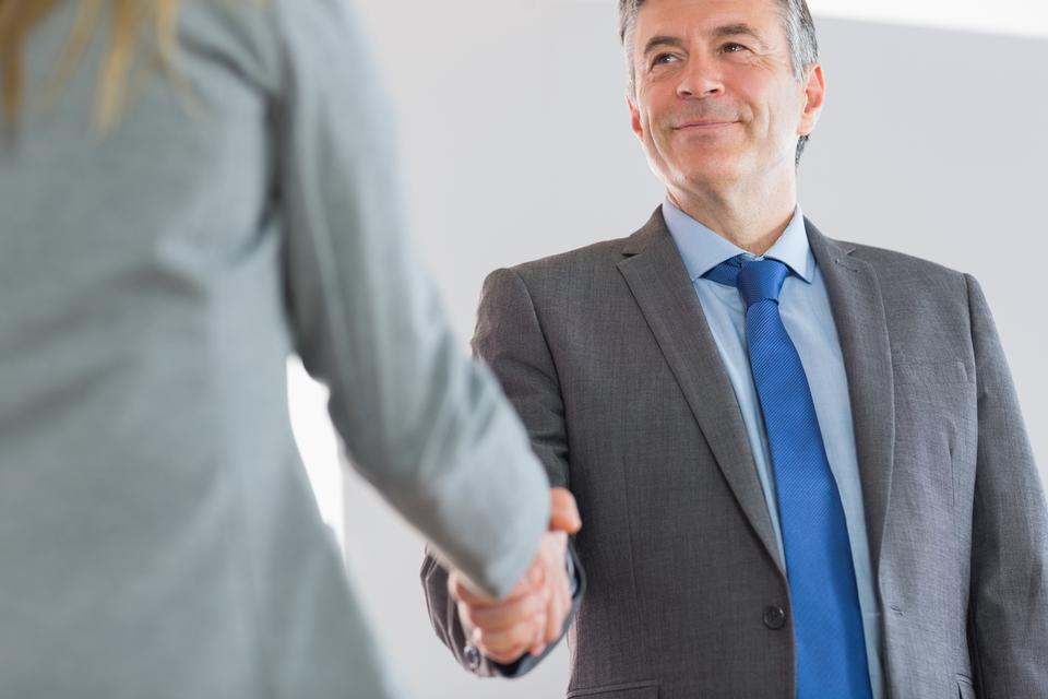 """""""Happy businessman shaking a hand"""" stock image"""
