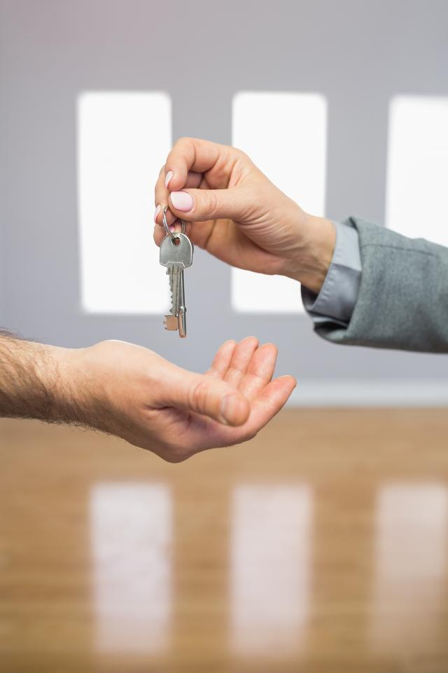 """""""Realtor giving house key to buyer"""" stock image"""