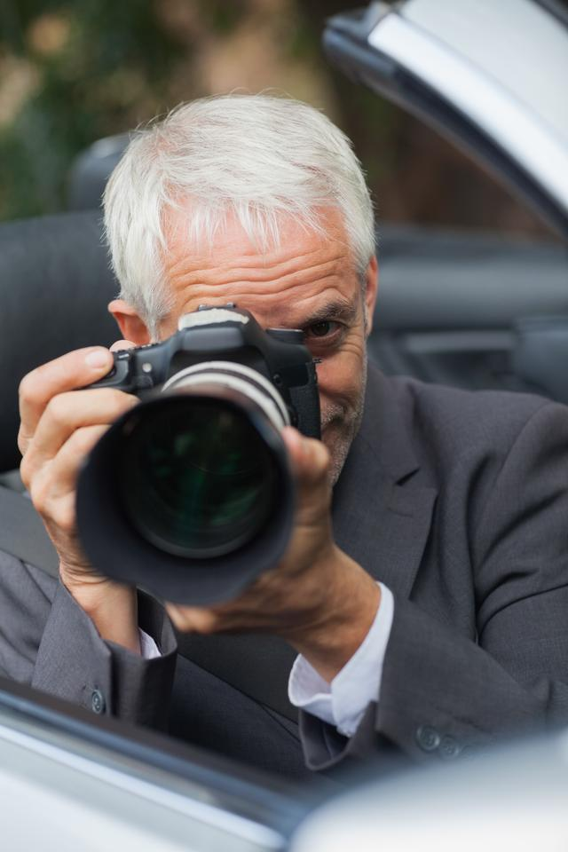 """""""Mature paparazzi taking picture with professional camera"""" stock image"""