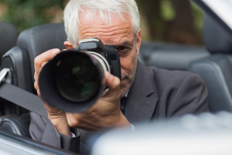 """""""Paparazzi taking picture with his professional camera"""" stock image"""