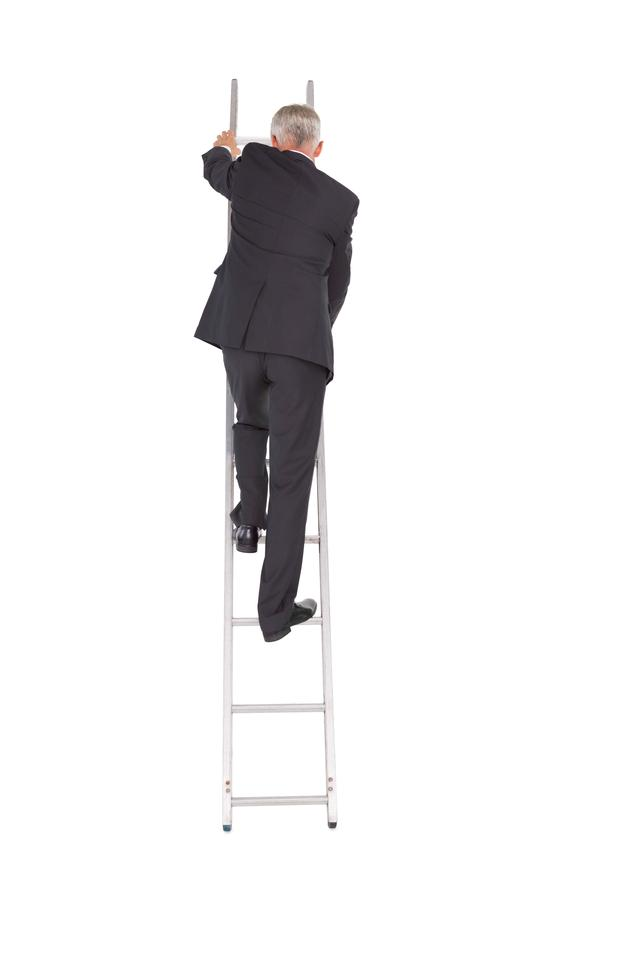 """Businessman climbing career ladder"" stock image"