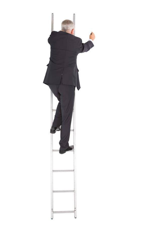"""Mature businessman climbing career ladder"" stock image"