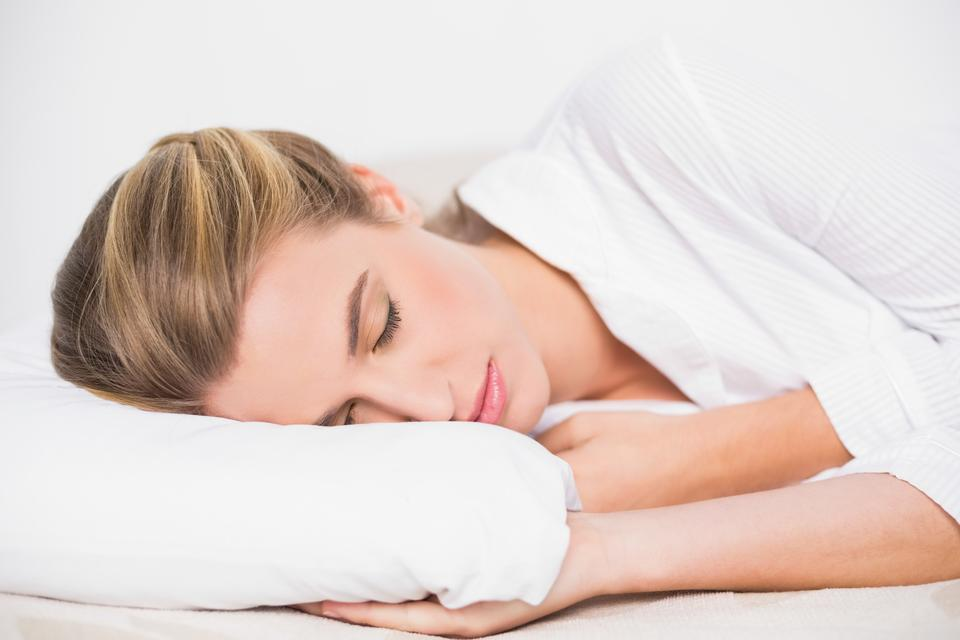 """""""Cute model sleeping in cosy bed"""" stock image"""
