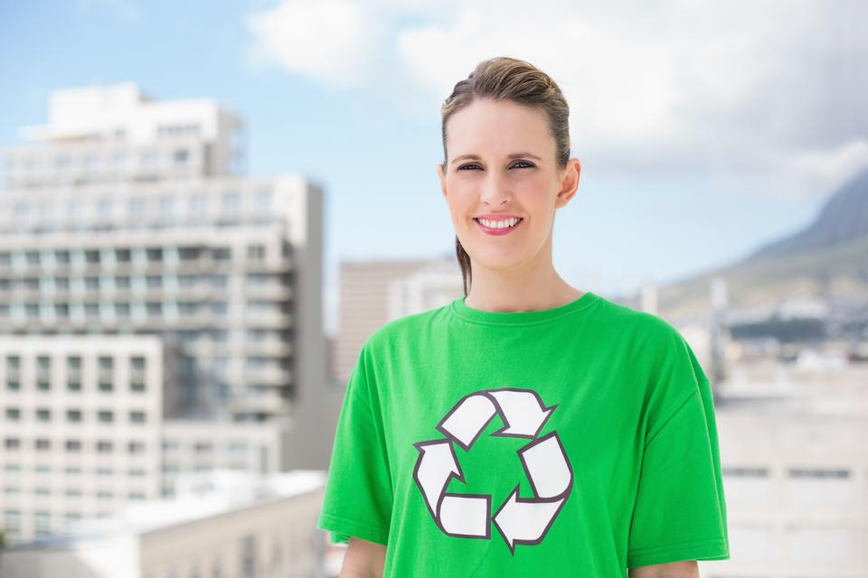 """Smiling environmental activist outside"" stock image"