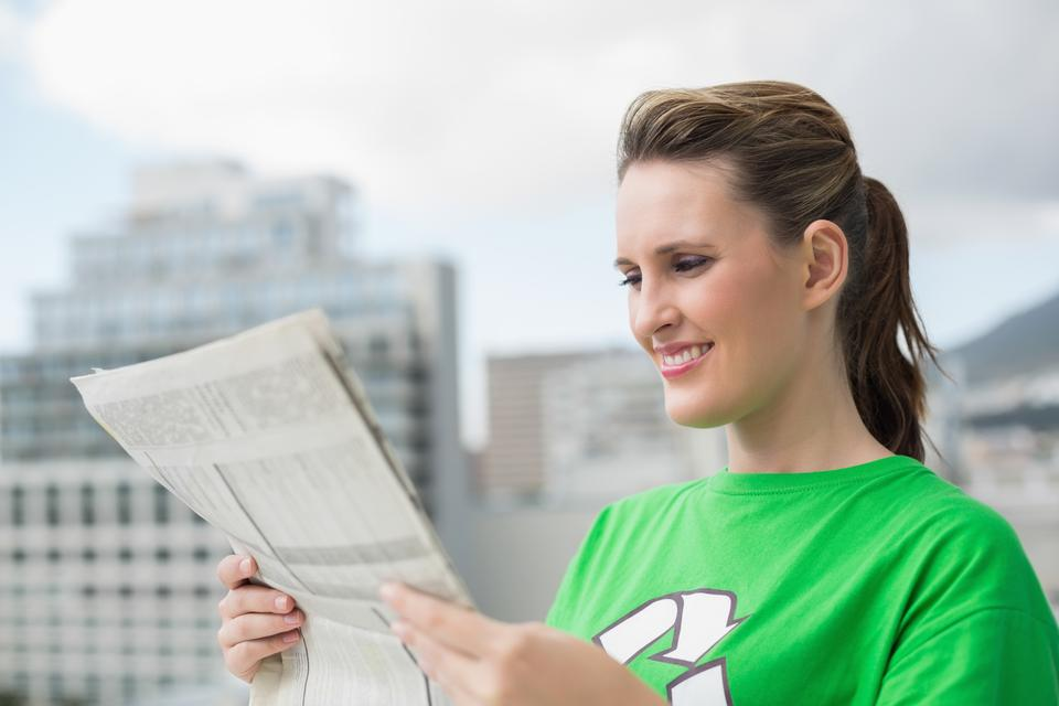 """Environmental activist reading newspaper"" stock image"