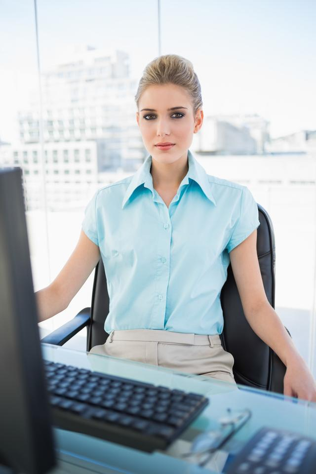 """Serious classy businesswoman posing"" stock image"