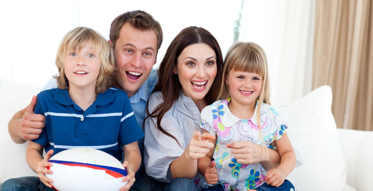 """""""Happy family watching a rugby match"""" stock image"""