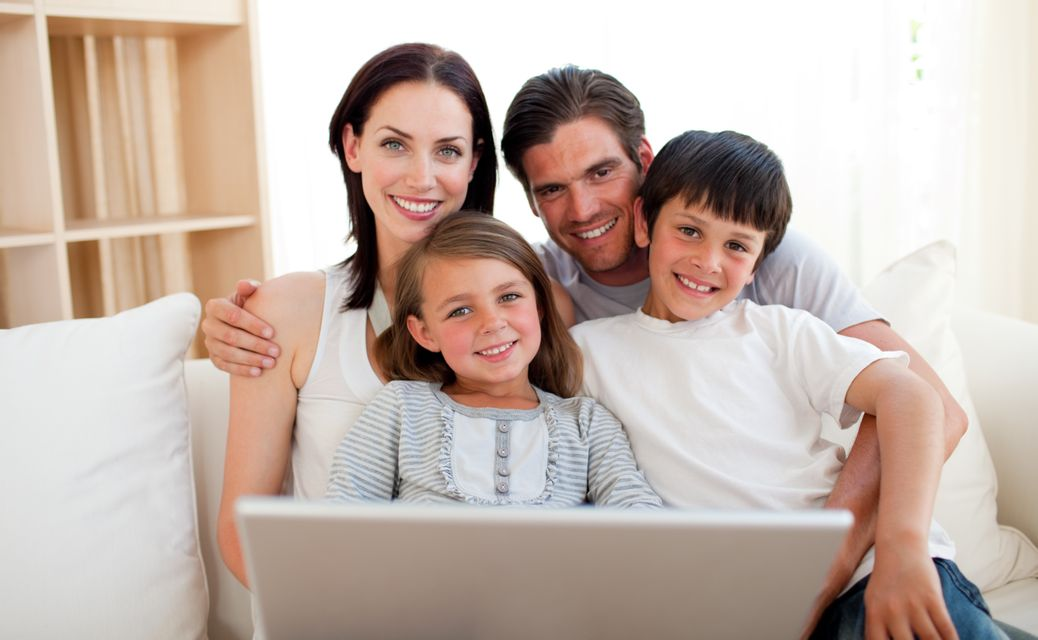"""""""Happy family surfing the internet"""" stock image"""