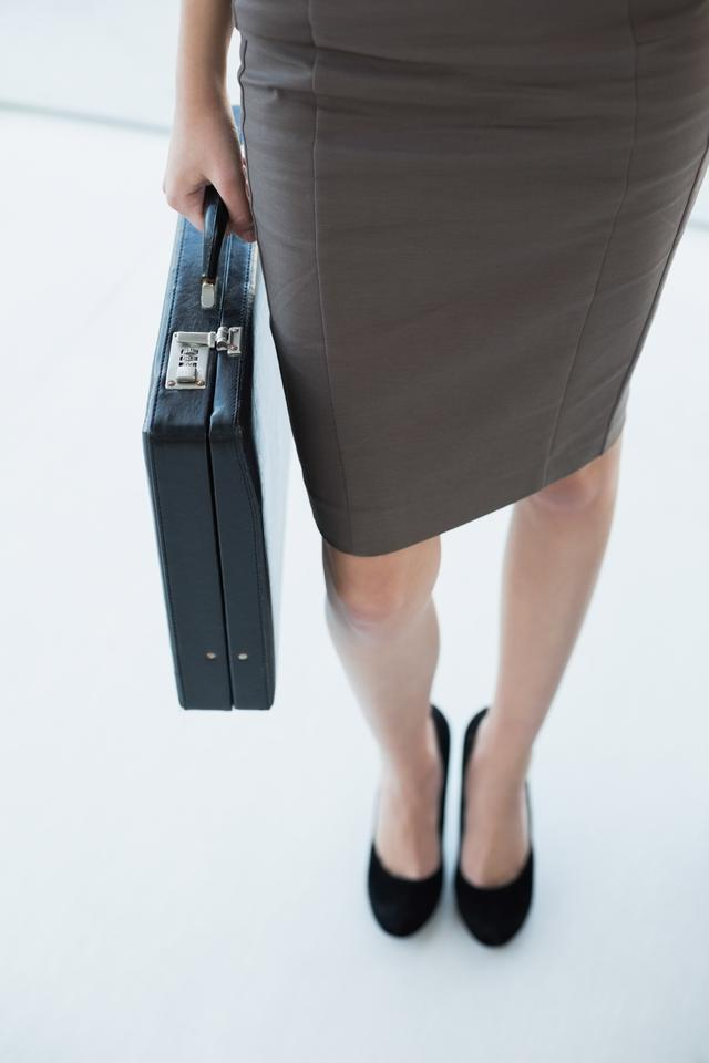 """Classy businesswoman holding a black briefcase"" stock image"