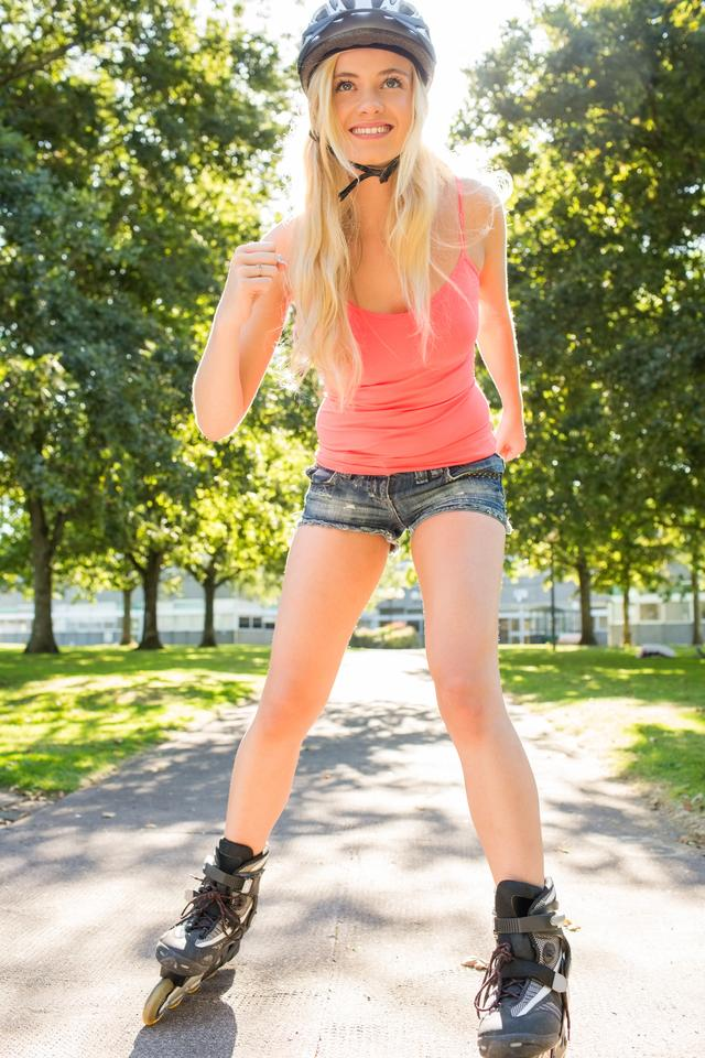 """Casual happy blonde inline skating"" stock image"