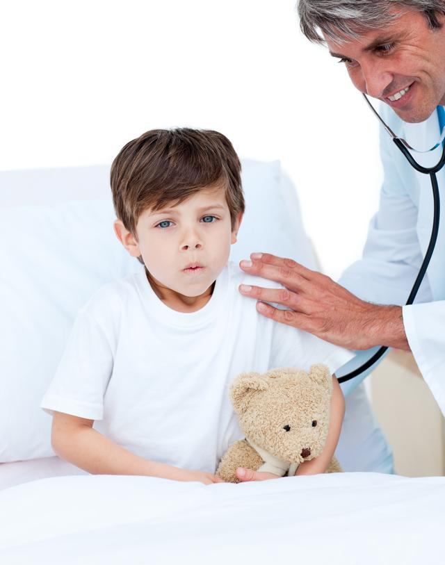 """Cute little boy attending a medical checkup"" stock image"